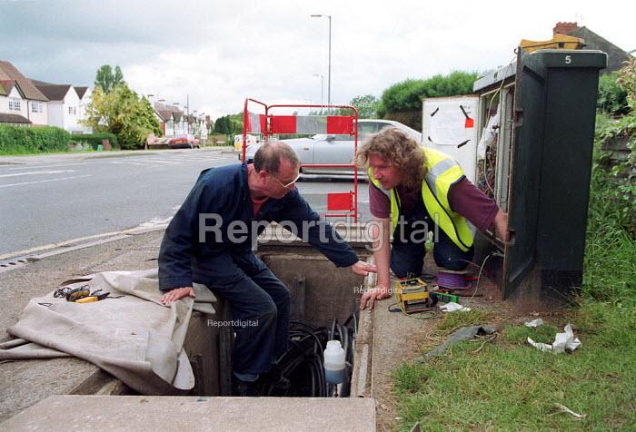 BT engineers repairing a PCP cabinet box. - John Harris - 2000-06-07