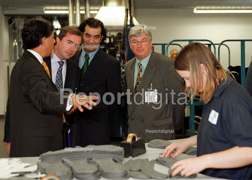 Hamid Kharn Chief Executive of Courtaulds showing trade union officials: Ed Sweeney UNIFI, Kamaljeet Jandu TUC Race & equality officer, and Paul Gates KFAT around Courtaulds sock factory Leicester. - John Harris - 2000-06-13