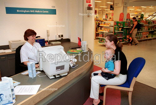 Patient, mother and baby, at NHS walk-in centre in Boots Birmingham, which offers assessment by an experienced NHS nurse who can give healthcare advice, information and treatment. No appointment is necessary. - John Harris - 2000-06-16