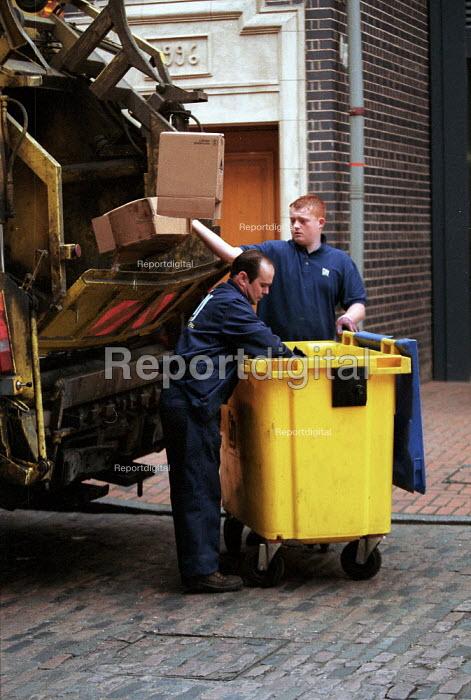 Dustbin men emptying wheelybin of rubbish into a dustcart, Birmingham. - John Harris - 2000-06-20