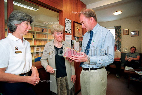 Nurse, receptionist and Doctor in discussion in GP surgery. - John Harris - 2000-06-29