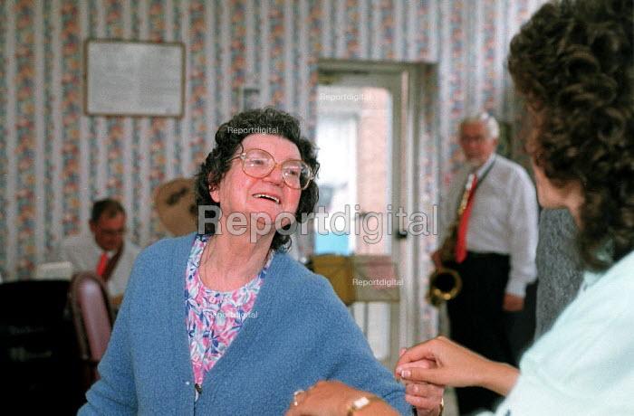 Elderly women dancing at Old Peoples Home. - John Harris - 2000-07-01