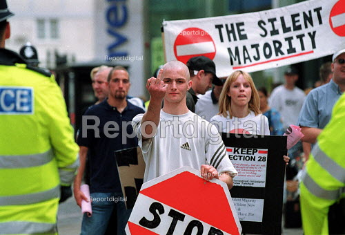 Police guarding fascist National Front skinheads protesting against Gay Pride march and in favour of Section 28 which prevents discussion of homosexuality in schools. - John Harris - 2000-07-29