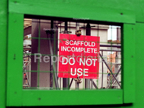A building site Health and safety notice warning of the danger of incomplete scaffold. Construction site Worcester. - John Harris - 2000-10-04