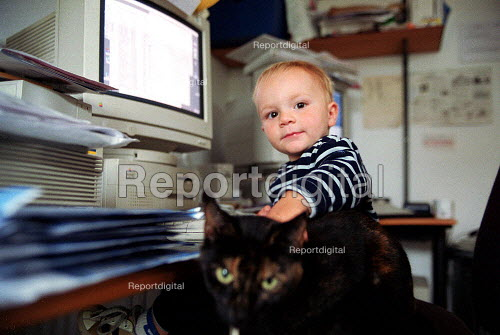 Emilio stroking the cat and checking the computer in the home office, aged 16 months. - John Harris - 2000-10-20
