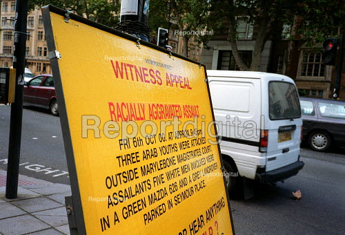 Police sign in the street: witness appeal in a case of racially aggravated assault. - John Harris - 2000-10-30