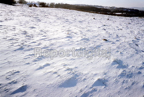 Snow on a footpath across arable farmland. Dover's Hill in the Cotswolds. - John Harris - 2000-12-26