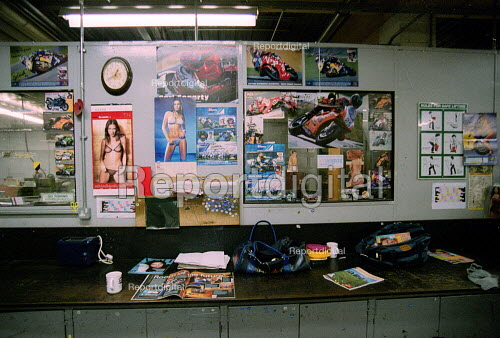 Work bench in engineering dept. with motorcycle and pornography pin ups. - John Harris - 2001-01-16