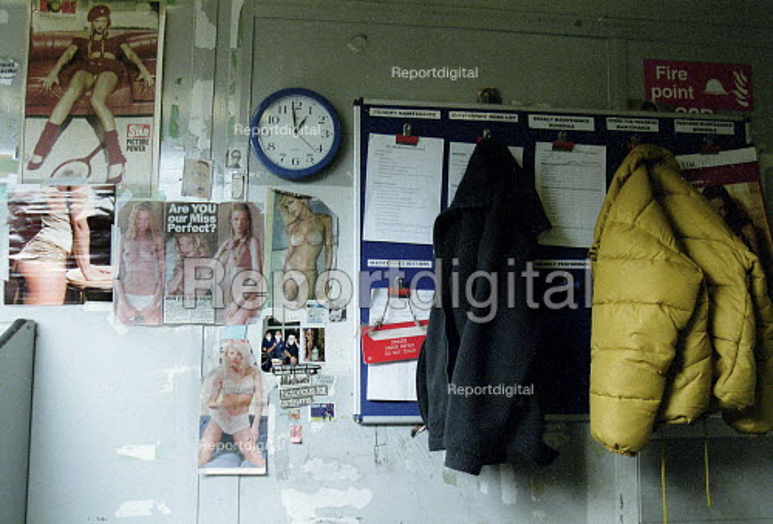 Notice board coats clock and pornography pin ups. - John Harris - 2001-01-16