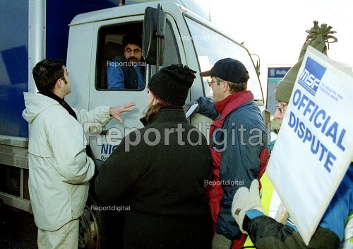 Pickets try to persuade a lorry driver not to cross the picket line. Rolls-Royce workers picketing during a one day strike against redundancies and job losses. It is the first strike for 20 years by MSF and GMB trades union members. Ansty Coventry. - John Harris - 2001-02-09