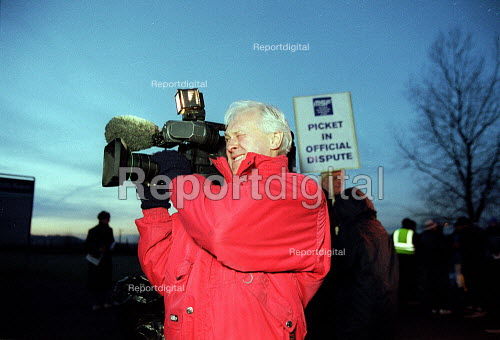 TV camera crew filming Rolls-Royce workers picketing during a one day strike against redundancies and job losses. It is the first strike for 20 years by MSF and GMB trades union members. Ansty Coventry. - John Harris - 2001-02-09