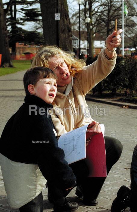 Teacher helping young schoolboy to sketch. - John Harris - 2001-03-06