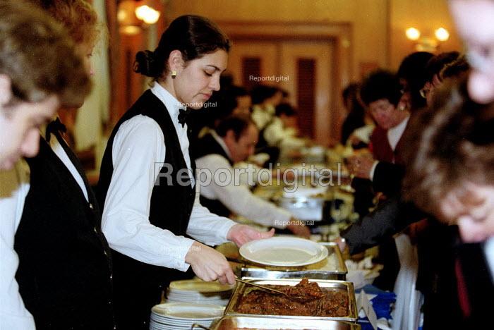 Hotel catering workers serving food. - John Harris - 2001-03-09