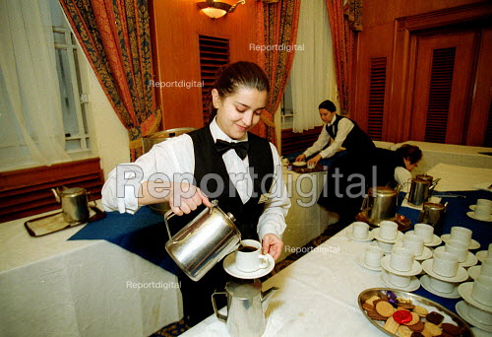 Hotel catering workers serving coffee. - John Harris - 2001-03-09
