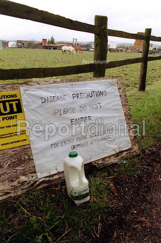 Milk delivery by do not enter sign, foot and mouth disease precautions at an entrance to a farm in an at risk area. - John Harris - 2001-03-28