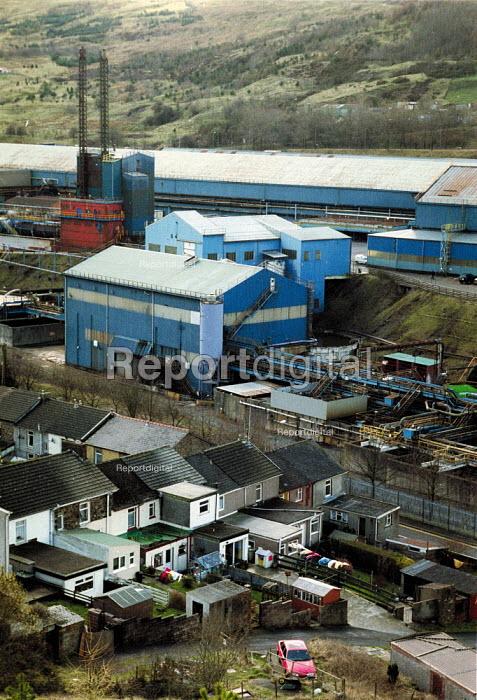 Terraced houses by Corus Ebbw Vale steelworks, South Wales valleys. - John Harris - 2001-04-04