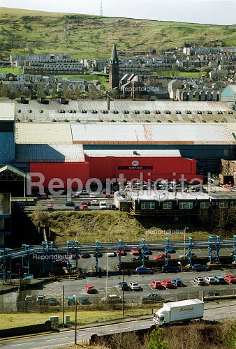 Terraced houses and a church above Corus Ebbw Vale steelworks, South Wales valleys. - John Harris - 2001-04-04