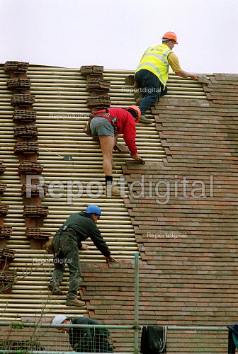 Roofers laying roof tiles. - John Harris - 2001-04-11
