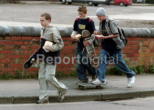 Teenagers with skateboards and fast food. - John Harris - 2001-04-11