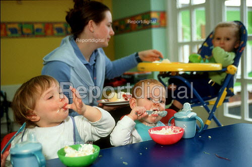 Toddlers eating lunch at a day time nursery. - John Harris - 2001-04-10