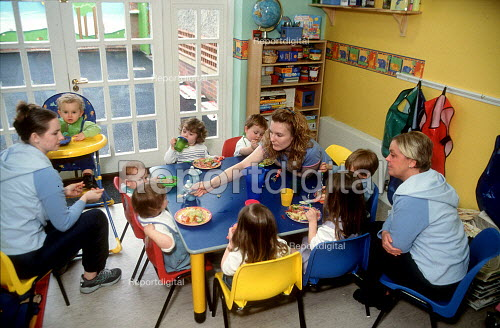 Nursery assistants feeding toddlers lunch at a day time nursery. - John Harris - 2001-04-10