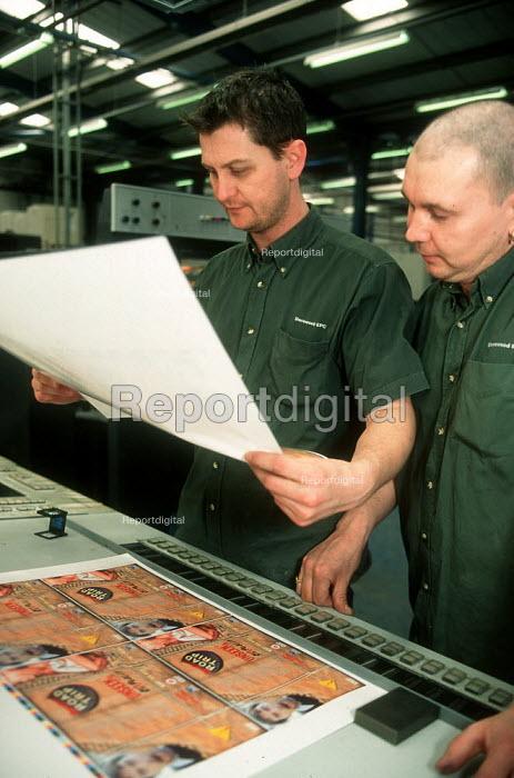 Printers checking print quality at printing factory. - John Harris - 2001-04-04