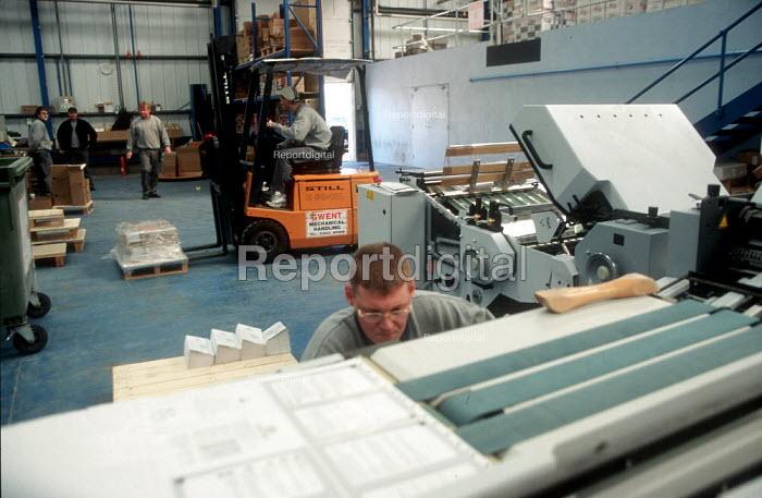 Printer checking print quality at printing factory. - John Harris - 2001-04-04
