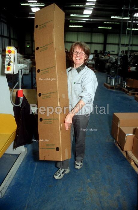 Woman printer moving cardboard boxes at printing factory. - John Harris - 2001-04-04