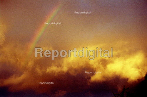 Rainbow and storm clouds lit by sunset. - John Harris - 2001-04-22