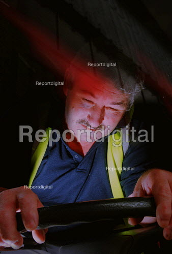 HGV driver falling asleep at the wheel. posed by a model. - John Harris - 2000-06-23