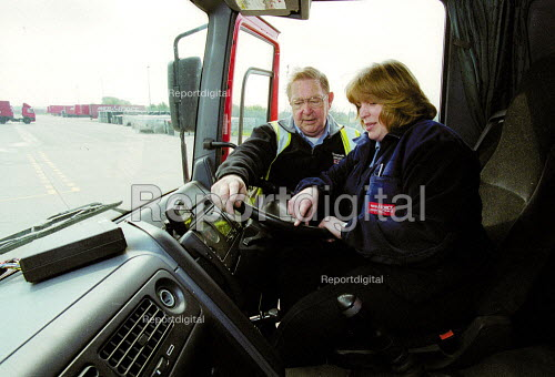 HGV driving instructor and women truck driver with a 38 ton lorry, having just passed her HGV license driving test. Parcel Force Royal Mail Coventry Hub. - John Harris - 2001-05-10