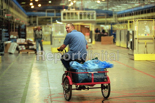 Post Officer worker on his bike, parcels with automated line. Post Office Parcel Force Royal Mail Coventry Hub distribution centre. - John Harris - 2001-05-10