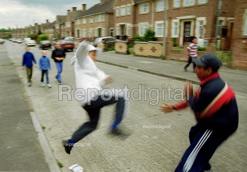 Fighting in the street on a council housing estate Gloucester. - John Harris - 2001-05-19