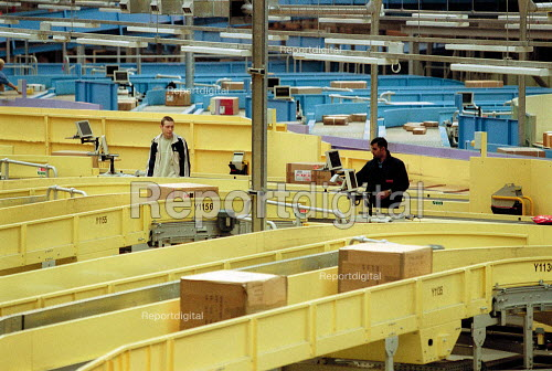 Post Office workers operating automated line in sorting office. Post Office Parcel Force Royal Mail Coventry Hub distribution. - John Harris - 2001-05-10