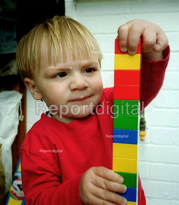 Toddler making a tower at 23 months old. - John Harris - 2001-05-18