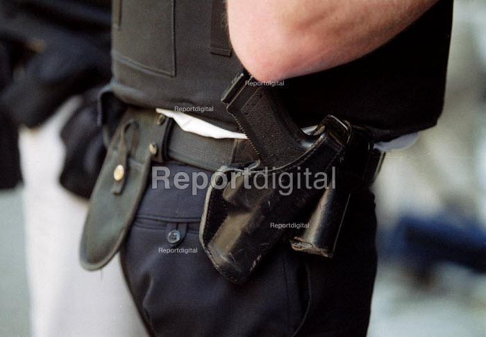 Armed policeman with pistol. Downing Street London - John Harris - 2001-06-08