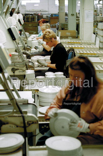 Women workers inspecting and stacking plates on a production line at a ceramics factory in the Potteries, Stoke on Trent. - John Harris - 2001-06-14