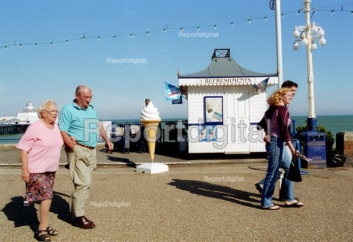 Elderly couple and young couple walking on the seafront, Eastbourne. - John Harris - 2001-06-14