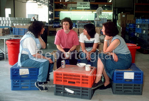 CATU Trades union representative talking with members taking a break about impending redundancy at a Churchill ceramics factory in the Potteries, Stoke on Trent. - John Harris - 2001-06-14