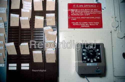 Clocking on time cards and clock at a factory. - John Harris - 2001-06-14