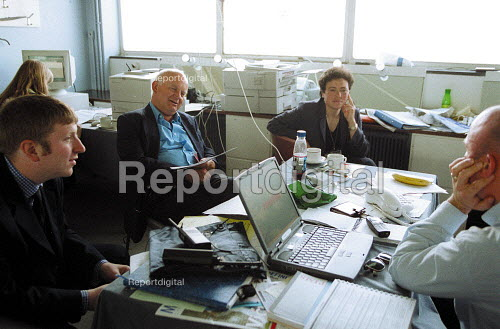 Roger Lyons MSF with staff in a temporary office at conference. - John Harris - 2001-06-14