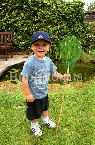 Emilio the fisherman with fishing net and garden pond, aged 2 years - John Harris - 2001-07-16