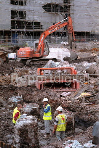 Construction workers on site with a manager, office development, Bristol. - John Harris - 2001-08-30