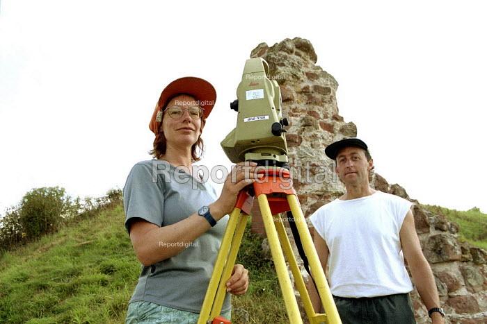 Wendy Owen and Nigel Jones archaeologists surveying Shrawdrine Castle using a Theodolite. - John Harris - 2001-08-29