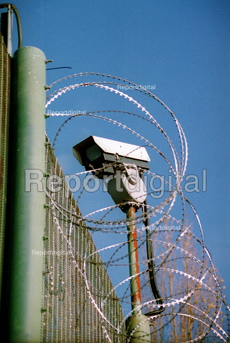 Security camera and razor wire along the fence. Campsfield Detention Centre. - John Harris - 2001-11-24