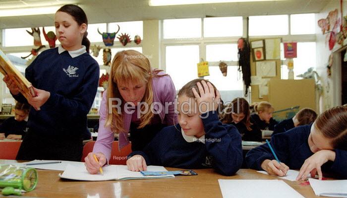 Teacher helping a pupil Art lesson Secondary School Wales. - John Harris - 2001-11-29