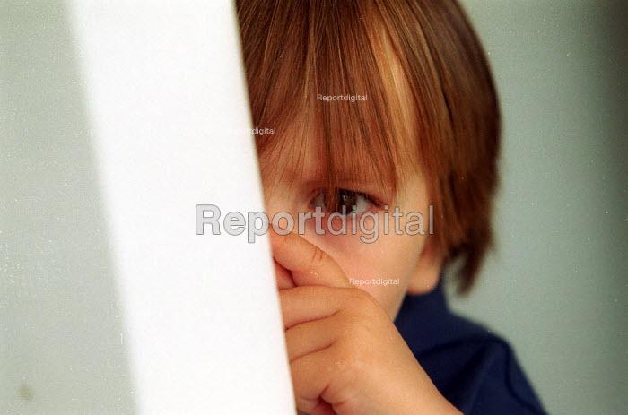 Toddler being shy. - John Harris - 2002-08-06