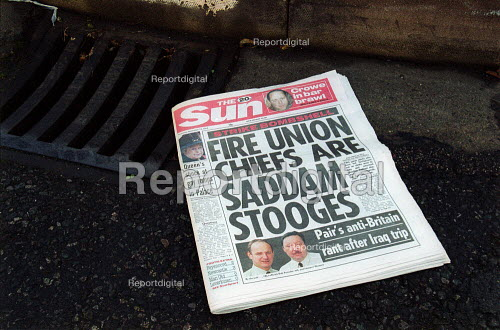 The Sun newspaper, which headline reads - Fire Union chiefs are Saddam Stooges - a story suggesting FBU leaders promoted Saddam Hussein. Firefighters strike. Stratford on Avon Fire station. - John Harris - 2002-11-15