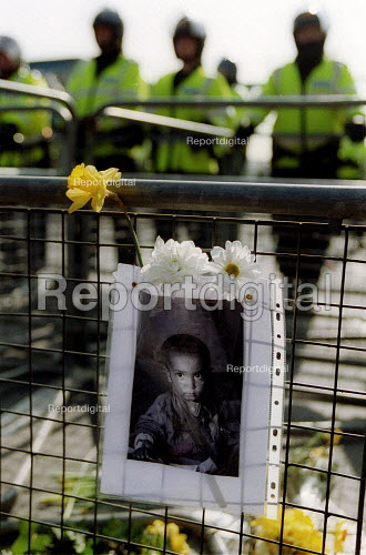 Portrait of a Iraq child and flowers.Anti war protest at RAF Fairford, where attacks on Iraq are being launched by USAF B52 bombers. Gloucestershire. - John Harris - 2003-03-22