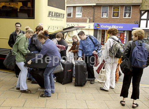 Tourists unloading their bags and cases from a coach. Stratford upon Avon, Warwickshire - John Harris - 2003-05-20